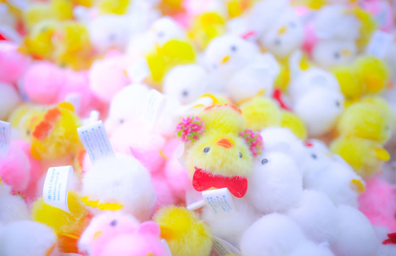 Bundles of cute brightly coloured toys. Bright Colourful KAWAII Pink Soft Toys Background Close-up Cute Multi Colored Pink Color Selective Focus Small Toy White Yellow