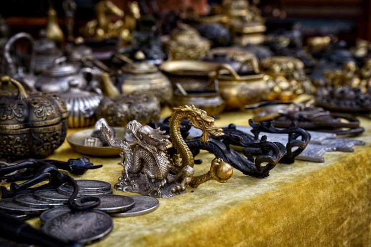 Dragon Travel Photography UNESCO World Heritage Site Antique Brass Chinese Culture Choice Close-up Collection Day For Sale Indoors  Large Group Of Objects Lijiang Market Stall No People Souvenirs Table Tourism Variation Vintage