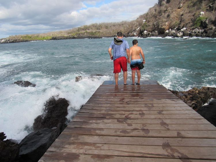 Father and son Sea Real People Water Two People Leisure Activity Nature Rear View Togetherness Day Sky Outdoors Standing Full Length Lifestyles Men Beauty In Nature Vacations Bonding Scenics Friendship An Eye For Travel Go Higher