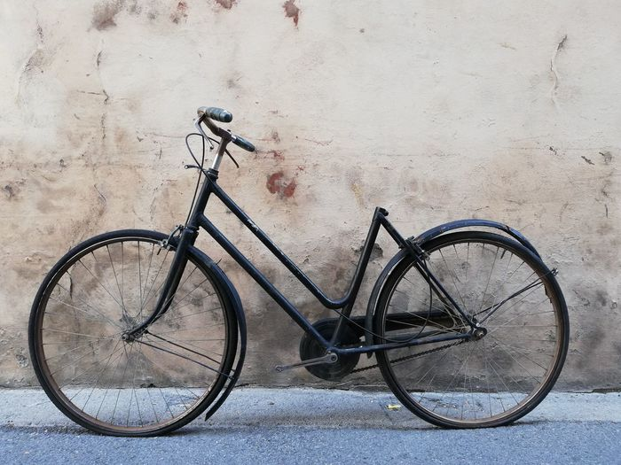 Bicycle leaning against wall