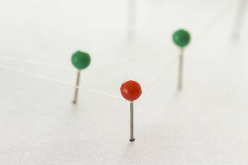 Pushpins connected Accuracy Cherry Close-up Focus On Foreground Green Color Indoors  Multi Colored Needle No People Red Science Selective Focus Sharp Simplicity Still Life Straight Pin Studio Shot Thumbtack White Background