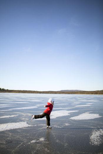 Full length of man on snow covered land against sky