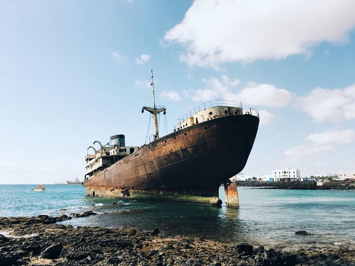 Abandoned ship Sky Cloud Horizontal Ocean Calm Ruins Nature Landscape Travel Abandoned Water Sky Sea Transportation Nautical Vessel Nature Cloud - Sky Mode Of Transportation Ship Beach Land No People