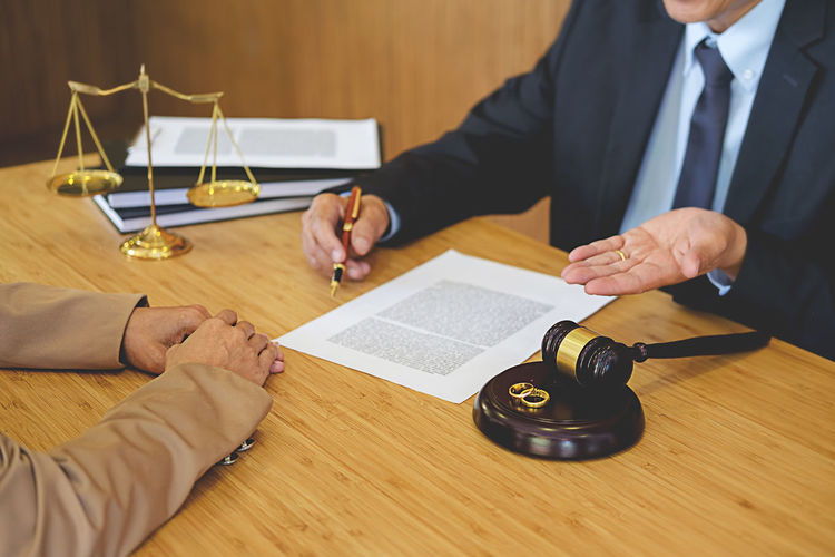 High angle view of client with lawyer
