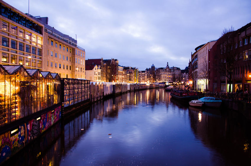 Amsterdam Canal in January. Amsterdam Amsterdam Canal Amsterdam Centraal Amsterdamcity Bike Bridge City Cityscape Cloud - Sky Dusk Illuminated Neon Lights Night No People Red Light District Reflection Reflection River Riverside Sky Travel Destinations Twilight Vacations View Water
