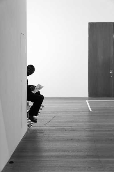 Leaning Black & White Blackandwhite Contrast EyeEm Gallery Indoors  Monochrome One Person Reading & Relaxing Real People Sitting