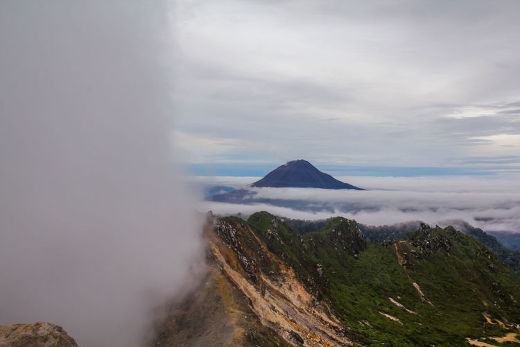Gunung Sinabung Volcano Cloud Sinabung Sunlight Active Beauty In Nature Cloud - Sky Day Fog Forest Gunung Haze Landscape Mist Mount Mountain Mountain Range Nature No People Outdoors Physical Geography Power In Nature Scenics Sibayak Sky Sunrise Tranquil Scene Tranquility Volcanic Landscape Volcano