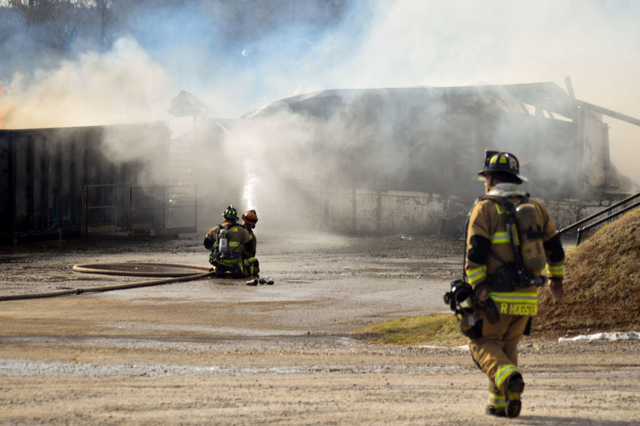 Firefighter Headwear Only Men Spraying Fire Hose Adults Only Adult Danger Smoke - Physical Structure Protective Workwear People Water Men Courage Accidents And Disasters Rear View Day Rescue Full Length Teamwork EyeEmNewHere Firemen Stockyard Meltonvisuals Lexington KY