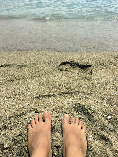 barefoot Beach Body Part Day High Angle View Human Body Part Human Foot Human Leg Land Lifestyles Low Section Nail Nature One Person Outdoors Personal Perspective Real People Sand Sea Sunlight Water