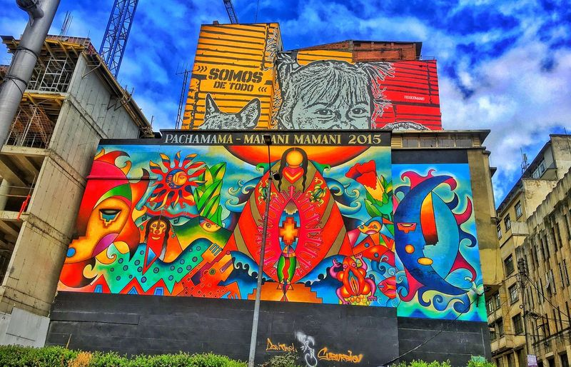 Graffiti Multi Colored Low Angle View Text Creativity Art And Craft Graffiti Building Exterior Architecture Day Built Structure Outdoors Sky Cloud - Sky Communication No People Chinese Dragon