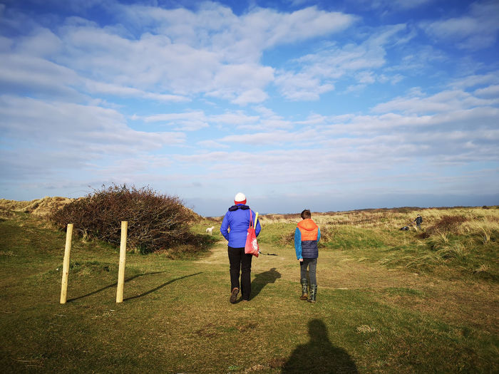 autumn walk over the dunes and down to the beach Shadows Autumn Walks Cold Days But Beautiful Sanddunes Full Length Child Togetherness Rural Scene Childhood Bonding Senior Adult Walking Boys Moments Of Happiness