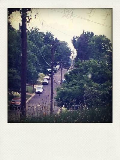 Our neighborhood. It's so cool because out street reminds me of Pittsburgh. Taking Photos