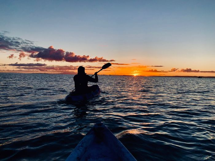 Sunrise kayaking. Kayak Sky Sunset Water Sea One Person Real People Leisure Activity Lifestyles Beauty In Nature Scenics - Nature Nature Silhouette Orange Color Men Transportation Motion Land Outdoors Horizon Over Water