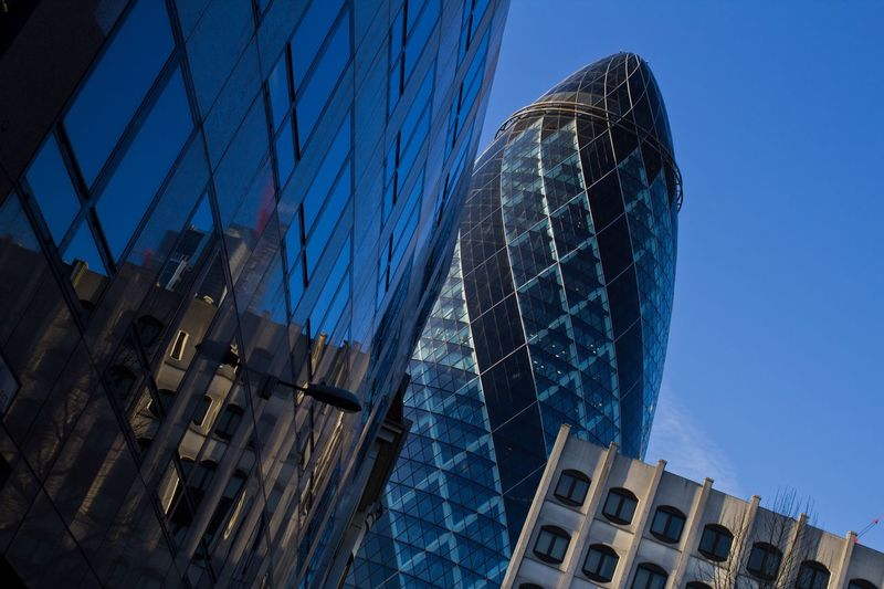 The Gherkin Building, City of London EyeEmNewHere Square Mile The City London Gherkin Building City Of London London The City Architecture Built Structure Building Exterior Modern Skyscraper Reflection City Office Building Exterior Low Angle View Corporate Business Blue Finance No People Day Outdoors Futuristic Business Office Park EyeEmNewHere The Graphic City