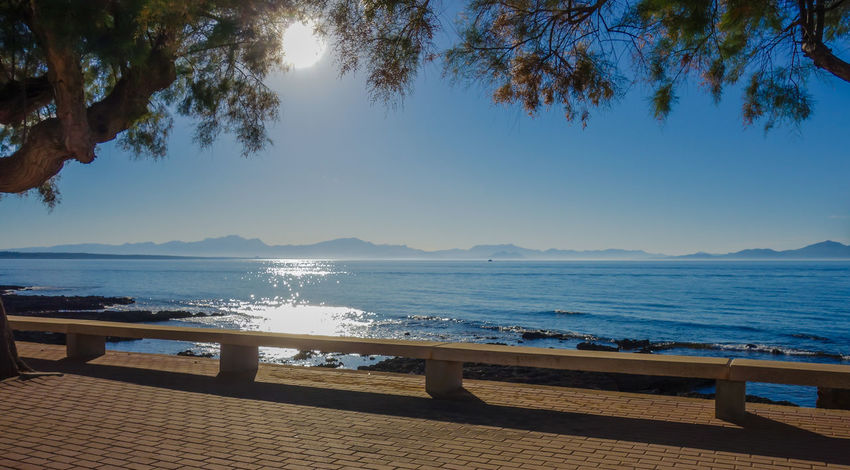 Colònia de Sant Pere - Bay of Alcudia Mallorca Beauty In Nature Colònia De Sant Pere Day Holiday Horizon Over Water Mallorca Mountain Nature No People Outdoors Promenade Scenics Sea Seating Bench Sky Sunlight Tranquil Scene Tranquility Tree Vacations Water