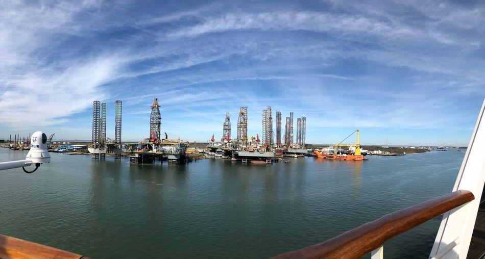 Fish-eye lens shot of commercial dock against sky