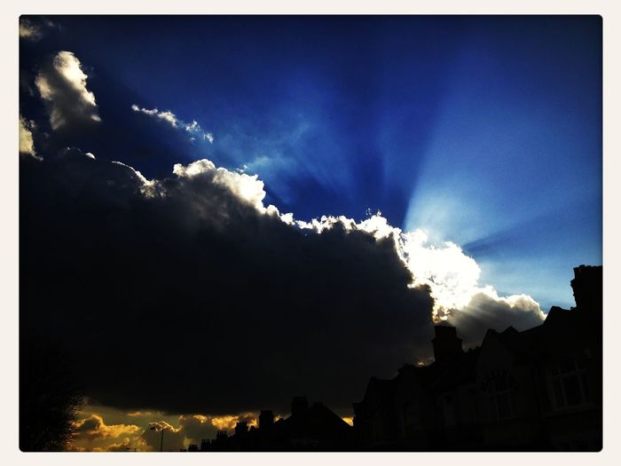 Clouds silver-lining sunrays