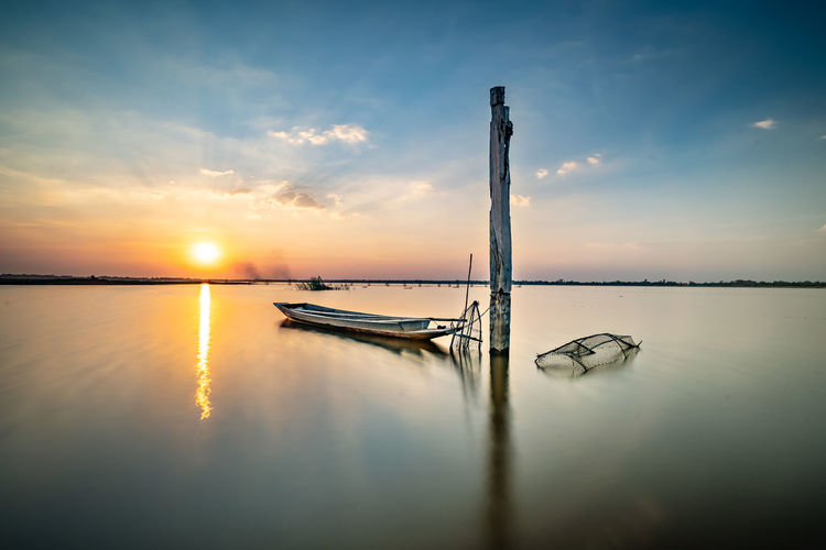 Water Sky Reflection Scenics - Nature Sunset Beauty In Nature Tranquility Tranquil Scene No People Nature Sea Idyllic Outdoors Boat On Sunset Twilight Sky