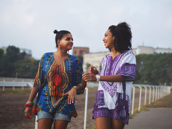Afro Beautiful Fashion Friends Girl Power Gossip Tropical Paradise A Afrohair Bestfriend Black Communication Conversation Day Girls Girly Mulatto  Outdoors Real People Style Talking Women Young Adult Young Woman Young Women