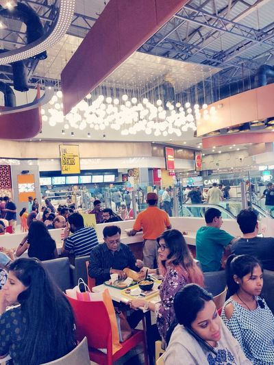 Busy Day in Mall of India Oneplus Oneplus6 Awesomely Noida Market Oneplusphotograpgy Krvishaljha EyeEm Crowd Men Women Business Sitting Student Group Of People Ceiling Ceiling Light  Crowded