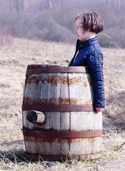I wish I were a pirate Waiting Alone Preschooler Barrel Wine Cask Spring Outdoors Keg Child Childhood Suitcase Full Length Pensive