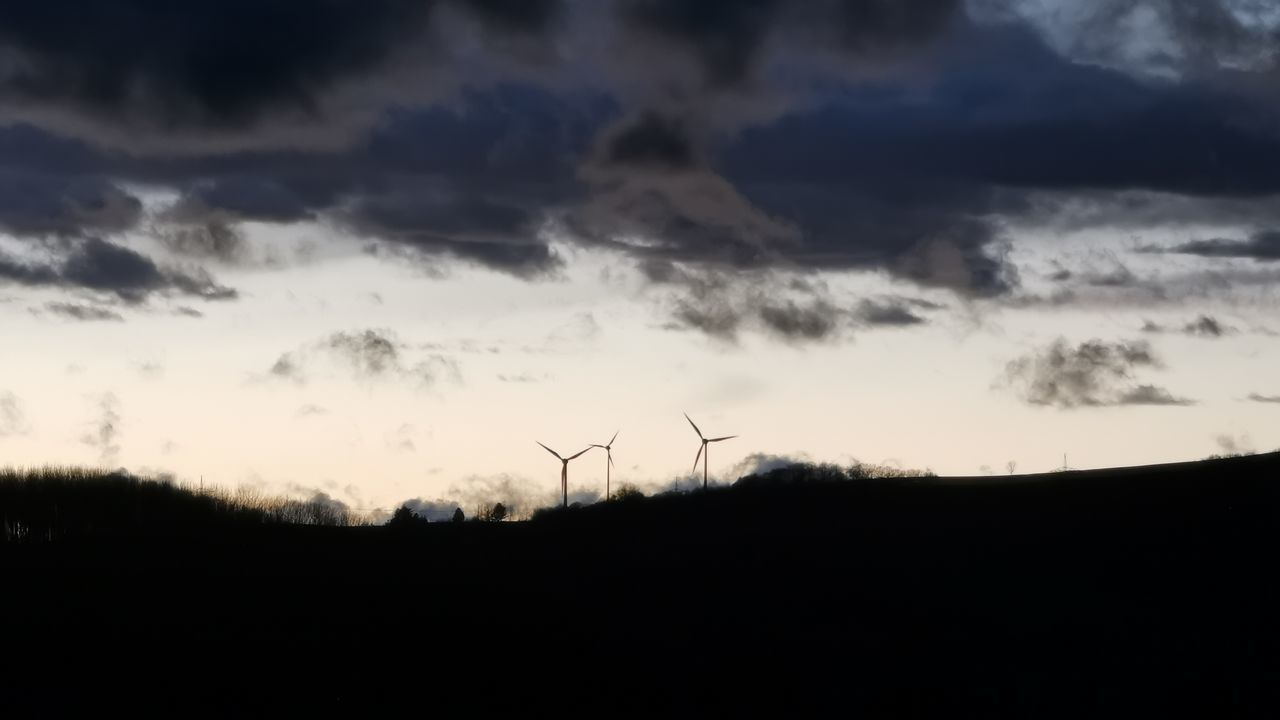 SILHOUETTE OF WIND TURBINES ON LAND