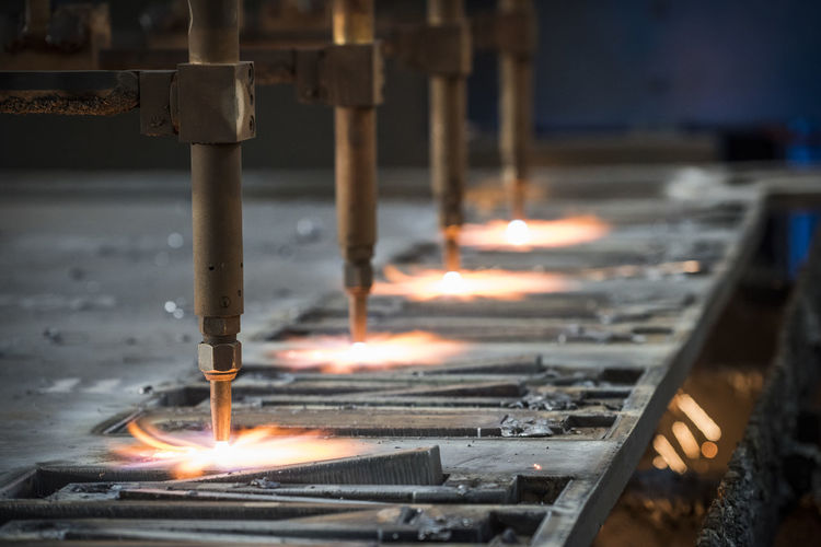 Laser cutting of metals in metallurgical industry Laser Laser Cut Factory Metal Industry Metal Manufacturing Equipment Sparks Plasma Machinery Industrial Technology Industry precision Metalwork Manufacture Machining Light Iron Cutting Production Tool Steel Cut Hard Work Close-up