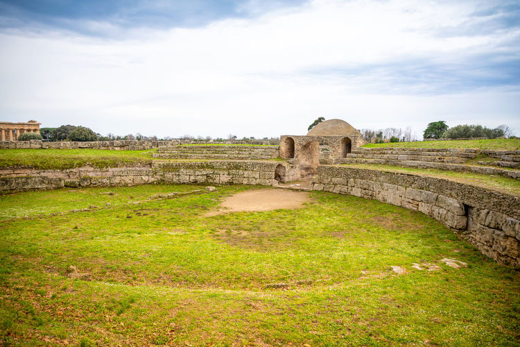 Italy Paestum Sky Architecture Built Structure Grass Cloud - Sky History Plant Nature The Past No People Day Ancient Landscape Environment Land Arch Green Color Connection Field Old Outdoors Ancient Civilization Arch Bridge