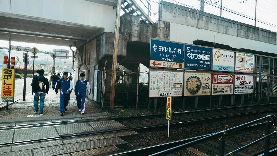 Boys Full Length Japan Japan Photography Men Public Transportation Rail Transportation Railroad Station Railroad Station Platform Railroad Track Real People Train - Vehicle Transportation Waiting