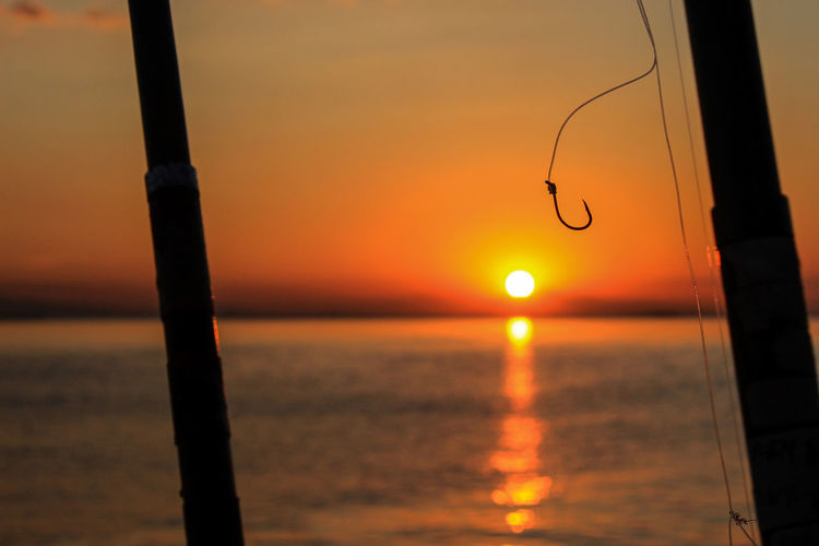 Hook Nature Orange Color Outdoors Sunlight No People Focus On Foreground Horizon Over Water