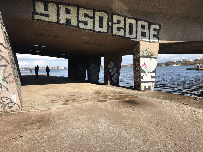 Graffiti on bridge over water