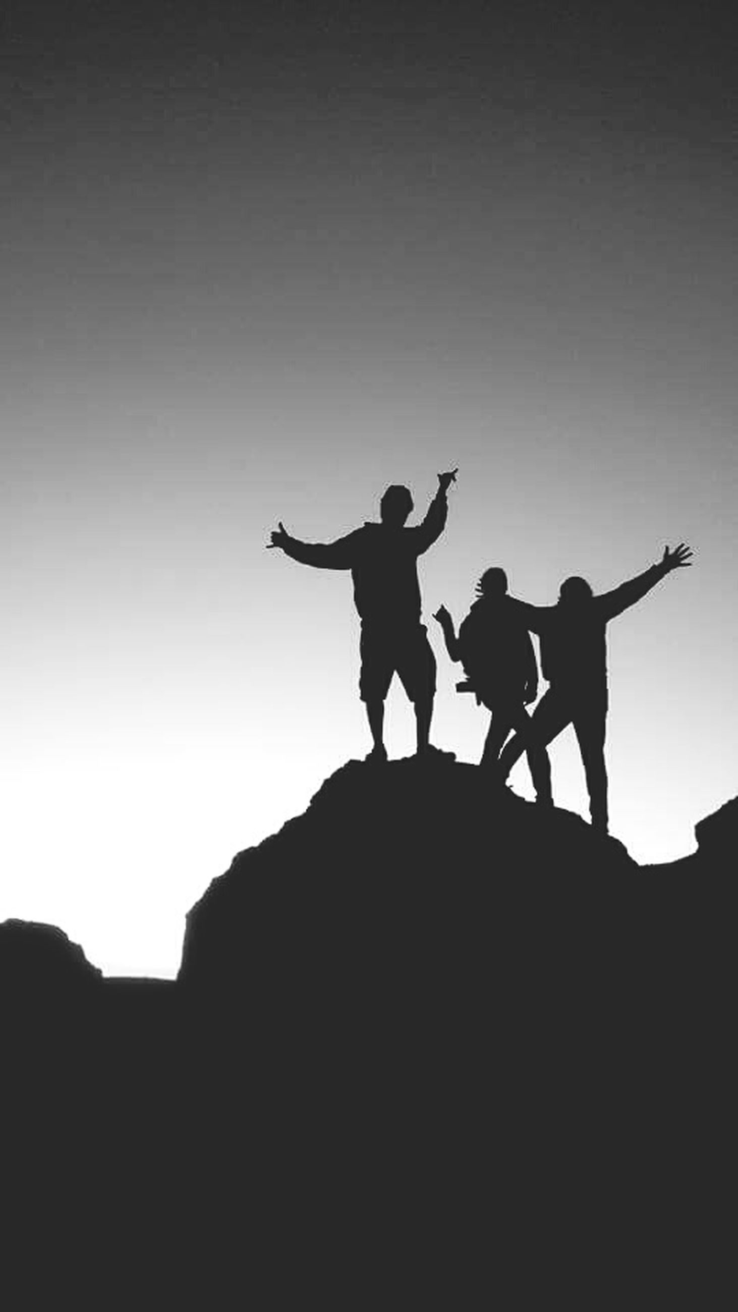 silhouette, low angle view, men, lifestyles, leisure activity, copy space, clear sky, full length, togetherness, sunset, sky, dusk, outdoors, outline, standing, person, skill