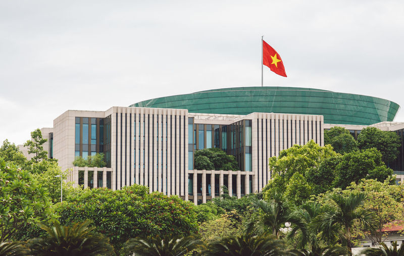 Low angle view of vietnamese flag on building in city