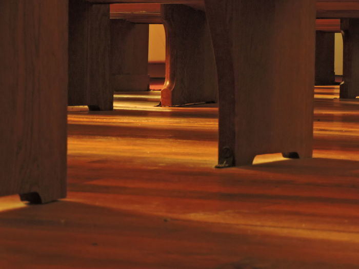 Light and Shadow under the Pews Light And Shadows Indoors  Architecture Architectural Column Wood - Material Built Structure No People Flooring Empty The Way Forward Building In A Row Day Wood Orange Color Sunlight Direction Brown Seat Low Section
