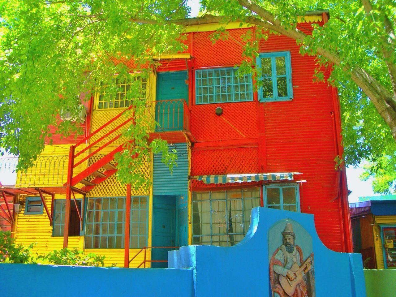 built structure, architecture, building exterior, tree, no people, house, low angle view, day, red, multi colored, outdoors