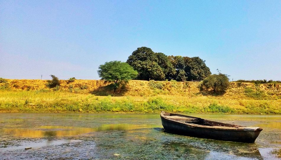 Water No People Tree Outdoors Day Reflection Nature Beauty In Nature Sky Boat River Riverside Village Clear Sky Moto Nature Indianphotography India Varanasi UttarPradesh Clear Sky Satish Flow Water Green Greenery EyeEmNewHere