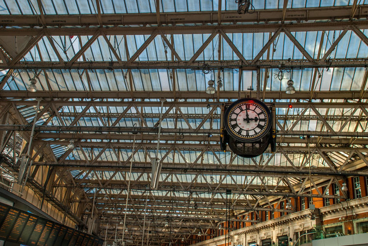The Clock hanging up of the Waterloo international train station in London Clock Time Architecture Built Structure Low Angle View Transportation No People Indoors  Day Metal Railroad Station Instrument Of Time Accuracy Clock Face Rail Transportation Industry Hanging Building Minute Hand Ceiling