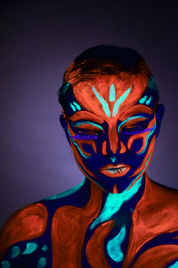 Close-up of human face against colored background