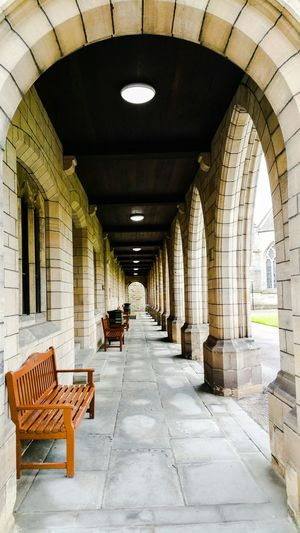 Empty Benches In Corridor