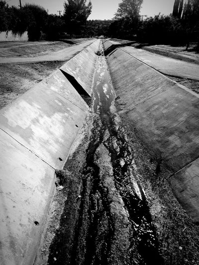 Urban River Black & White BW_photography Black And White Bw Bw_collection Urban City Urban Geometry High Contrast Blackandwhite Photography California Gulley Waterway Drainage Drain Water Tree Puddle Shadow Sky
