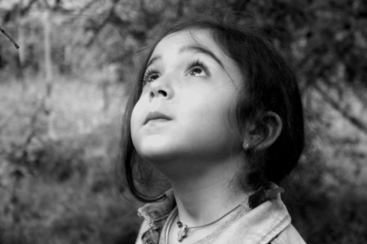 Portrait of girl looking up