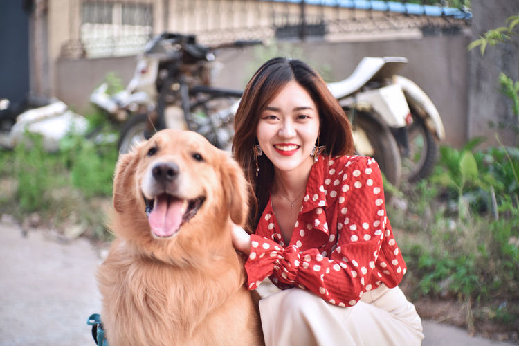 Portrait of smiling young woman with dog