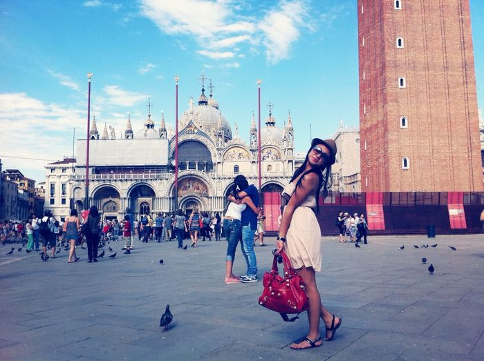 Woman standing in front of st mark cathedral against sky
