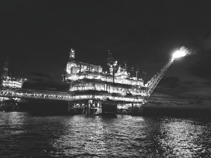 Black and white oil and gas platform Oil And Gas Industry Platform Blackandwhite Photography Water Sea Illuminated UnderSea Reflection Sky Lightning Forked Lightning Power In Nature