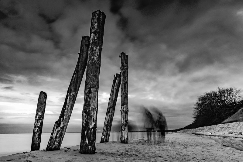 Ghost at the beach. Samyang 12mm f/2 NCS CS lens + 5 stop ND filter + CPL + 3 stop gradual ND filter. ACROS film simulation. Beach Black And White Blackandwhite Dark Day Dramatic Sky Ghost Landscape Long Long Exposure Nature No People Outdoor Outdoors Sea Sky Spooky Walking Water