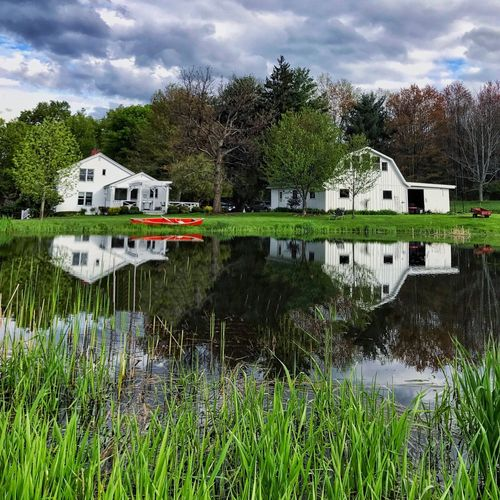 Pond Reflections Water Architecture Building Exterior Reflection Built Structure Tree Cloud - Sky Sky Barn Pond Reflections Outdoors Day Nature Grass Waterfront No People Tranquility Growth Scenics Country Living EyeEmNewHere BYOPaper! Neighborhood Map