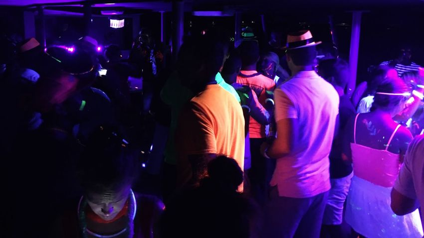 Message read Internet Addiction Bermuda Party Party Boat Booze Cruise! Neon Neon Party Checking Message