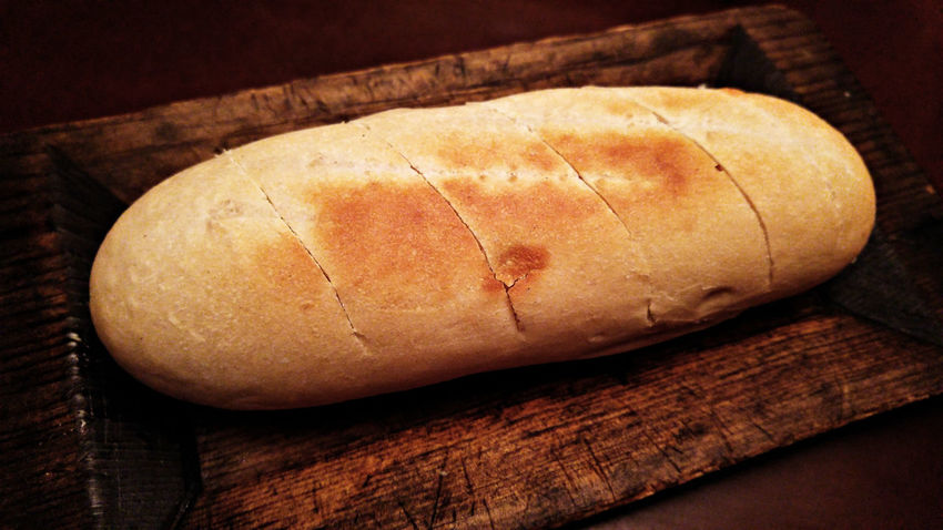 Baked Bread Bread On Wood Business Lunch Fine Art Food Fresh Baked Fresh Baked Bread Loaf Of Bread My World Of Food Restaurant Rustic Baked Rustic Bread Still Life Urban Photography Wood Table Loaf Of Rustic Bread