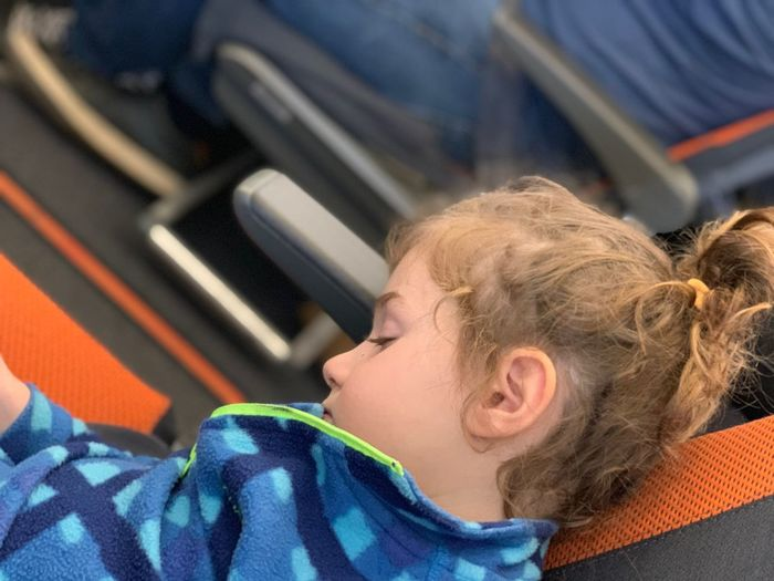 Travel Transport Plane Airplane One Person Child Headshot Childhood Portrait Sleeping Indoors  Relaxation Real People Eyes Closed  Lifestyles Lying Down Innocence Offspring