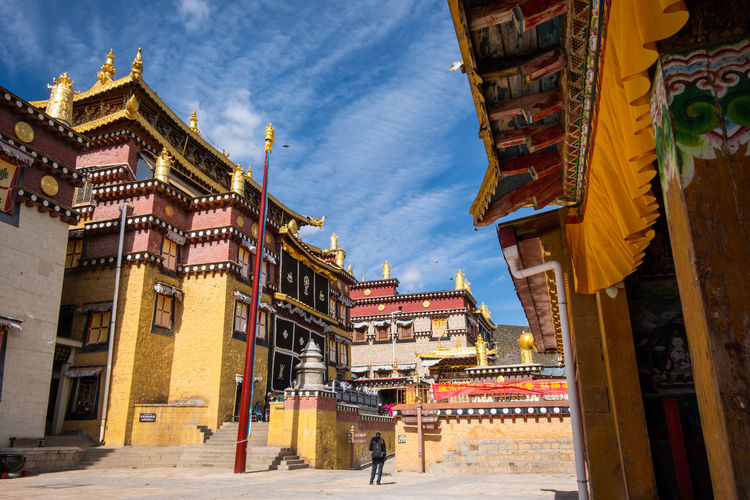Building Exterior Architecture Built Structure Building Sky Cloud - Sky Nature Belief City Religion Incidental People Spirituality Day Place Of Worship Real People Outdoors Men Street Travel Destinations Ornate Temple Shangrila Shangri-La Yunnan China Tibet Mountain